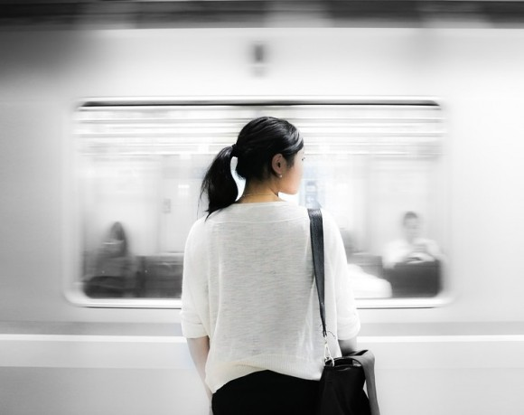 Chinese Girl Taking The Subway